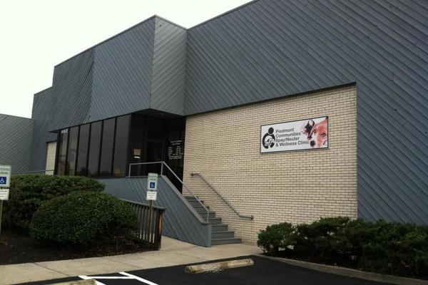 The view of the Clinic's building from the parking lot. We are located at the back of the building.